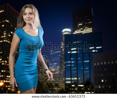 Beautiful young posing over night city background