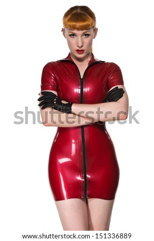 Beautiful young redhead in a red latex dress