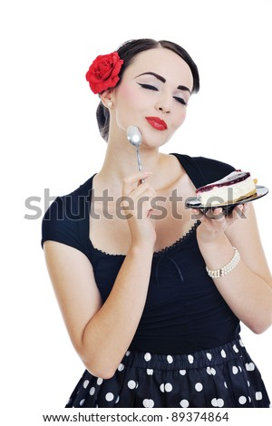 beautiful young retro pinup  woman eat sweet cake food isolated on white iin studio, representing diet and healthy concept