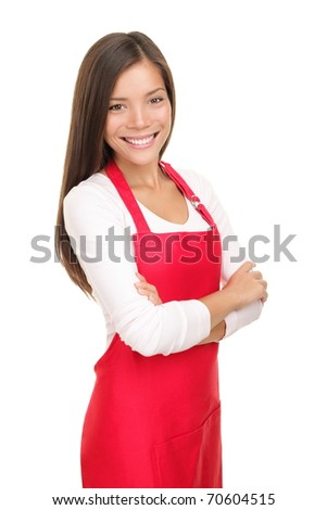 Beautiful young sales clerk or small shop owner isolated on white background. Smiling young woman.