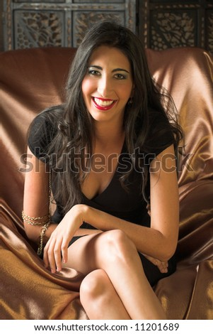 stock photo : Beautiful young sexy adult Italian woman with long black hair, ...