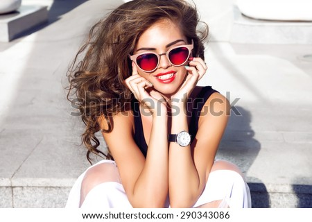 Beautiful young sexy brunette woman with bright evening make-up perfect smooth skin cosmetics cream face care,jewelry, beauty salon,magazine,close-up woman portrait hand watches,summer accessory,smile