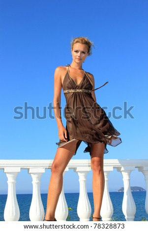 Beautiful young sexy fashion model by the sea in Greece