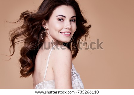 b4806e32cdf0c Beautiful young sexy girl with long wavy brunette hair with a bright  evening make up perfect