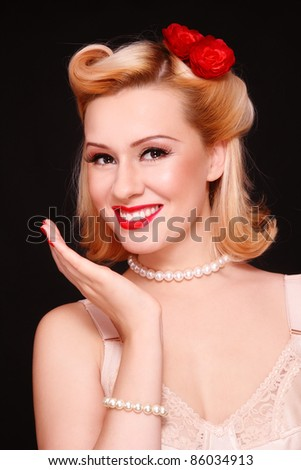 Beautiful young sexy laughing woman with vintage make-up and hairstyle