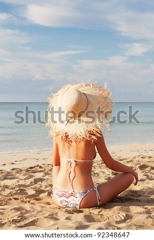 Beautiful young sexy woman relaxing on the beach