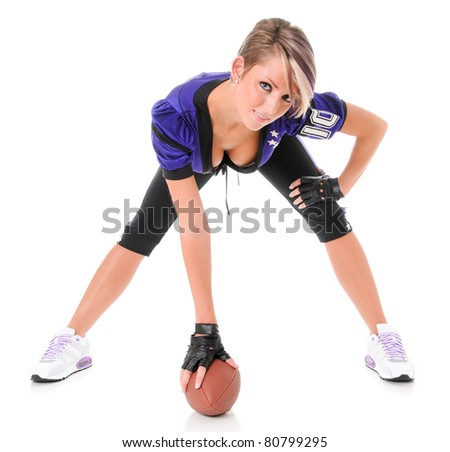 Beautiful Young Sexy Woman wearing American Football Uniform with Ball
