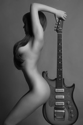 beautiful young sexy woman with guitar.musical girl
