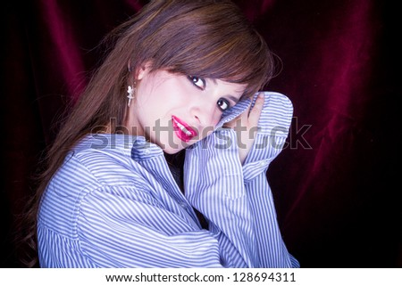 beautiful young sleepy woman with a mans shirt
