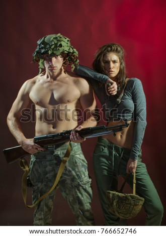 Beautiful young smiling couple in love embracing indoor. Shot of a passionate young people in love. Soldier, war, military. Sensual. Sexy erotic game play. Passionate concept. Passion. Sensuality. Sex #766652746