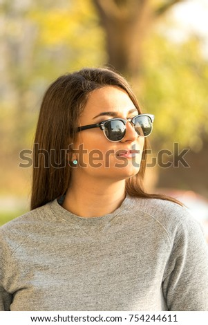 Beautiful young smiling girl headshot portrait with blurred background. #754244611