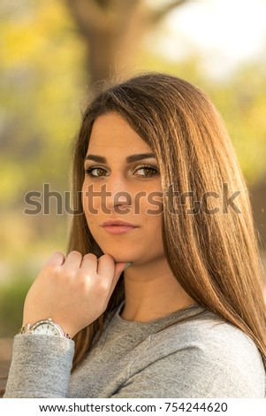 Beautiful young smiling girl headshot portrait with blurred background. #754244620