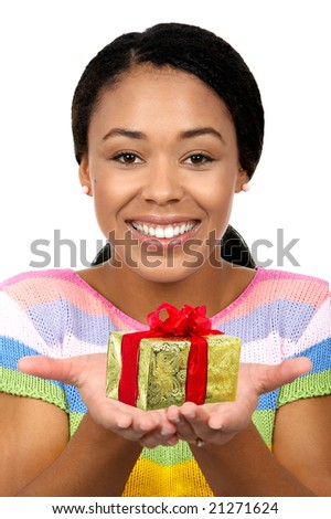 Beautiful young smiling woman with gift. Isolated over white  background