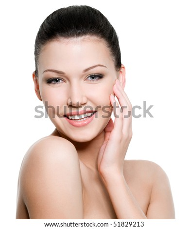Beautiful young smiling woman with healthy skin