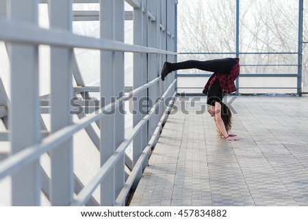 Beautiful young sports woman doing stretching outdoors in transition. The girl is engaged in fitness outdoors. #457834882