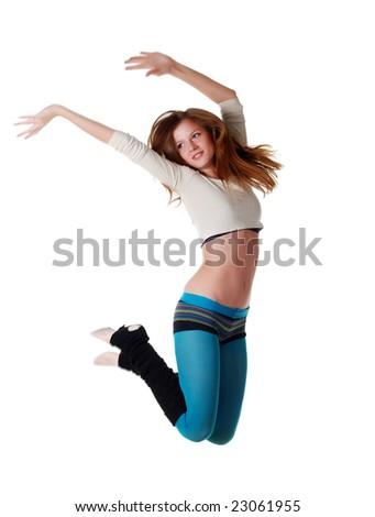 Beautiful young sports woman jumping at white background