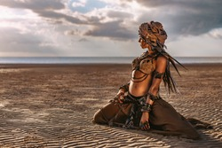 beautiful young stylish tribal woman in turban outdoors at sunset