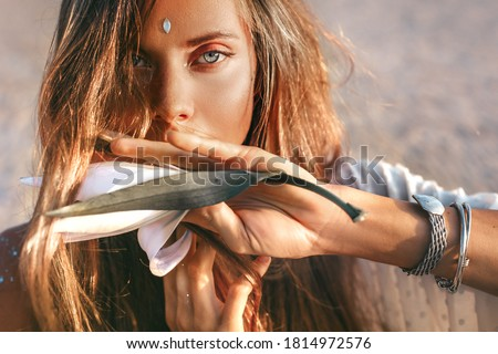 beautiful young stylish woman close up portrait with orchid flower at sunset Foto stock ©