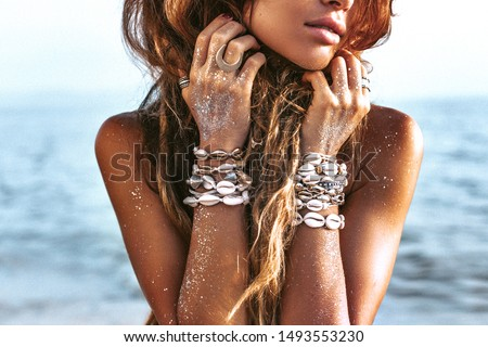 beautiful young stylish woman portrait on the beach at sunset Foto d'archivio ©
