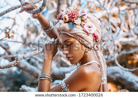 beautiful young stylish woman wearing flowers wreath outdoors portrait