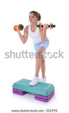Beautiful Young Teen Girl On Aerobic Step With Hand Weights.