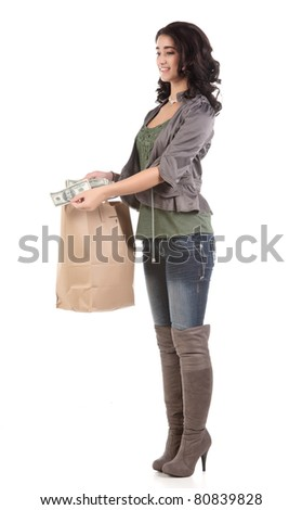 beautiful young teenage woman with shopping bag and cash