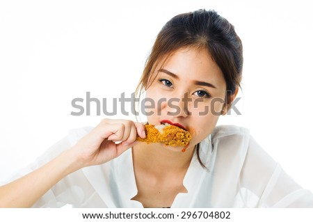 Beautiful young thai woman in white shirt crispy fried chicken on white background