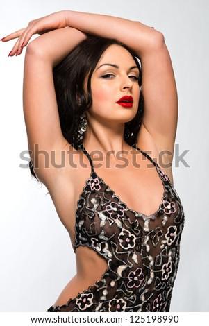Beautiful young Ukrainian woman in a sheer brown dress