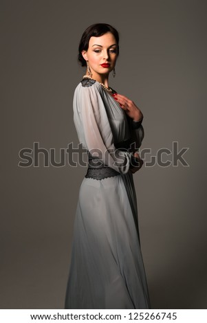 Beautiful young Ukrainian woman vintage gray gown