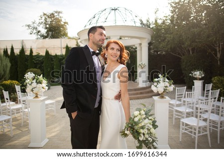 Beautiful young wedding couple posing outdoor Stockfoto ©