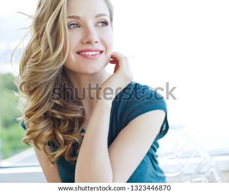 Beautiful young woman #1323446870