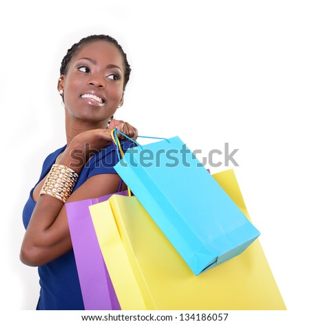 beautiful young woman african model holding colored shopping bags, over white