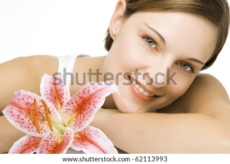 beautiful young woman and a lily in clean space
