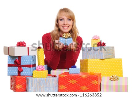 beautiful young woman and a pile of gift boxes. isolated on white background - stock photo