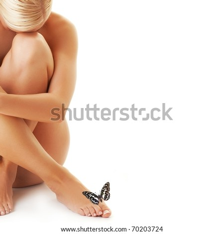 Beautiful young woman and butterfly sitting on her leg