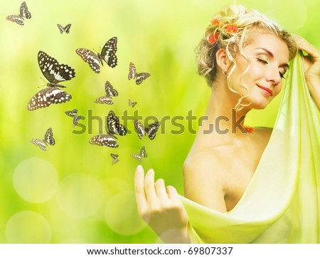 Beautiful young woman and flying butterfly