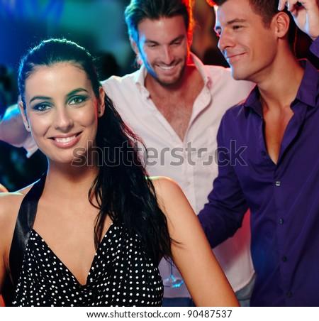 Beautiful young woman and friends having fun in nightclub.?