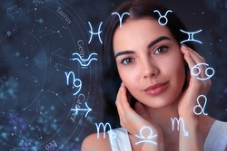 Beautiful young woman and illustration of zodiac wheel with astrological signs on dark background