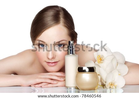Beautiful young woman and skincare products