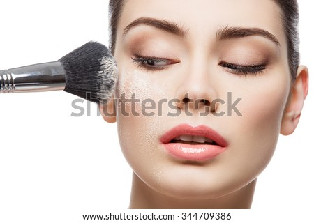 Beautiful young woman applying loose face powder with brush. Macro shot. Isolated over white background. Copy space. #344709386