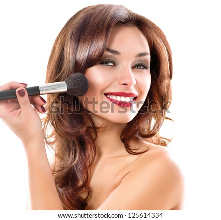 Beautiful Young Woman Applying Makeup. Brunette Girl Apply Make-up. Beauty Face. Isolated on White Background