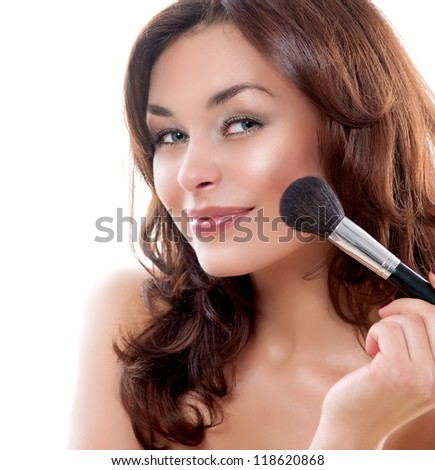Beautiful Young Woman Applying Makeup. Make-up. Beauty Face. Isolated on White Background