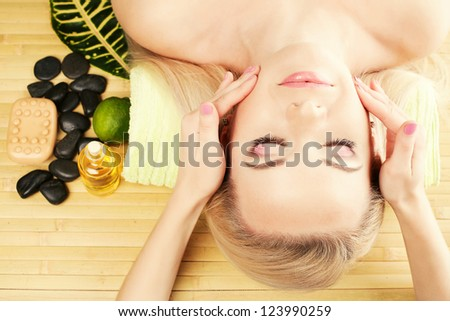 Beautiful young woman at a spa salon. Perfect Skin. Skincare. Young Skin - stock photo