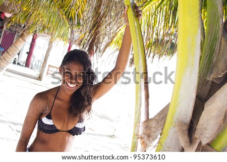 Beautiful young woman at a tropical beach