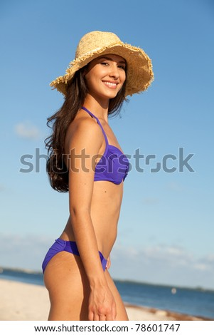 Beautiful young woman at the beach in Miami