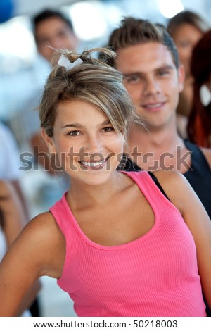 Beautiful young woman at the gym smiling