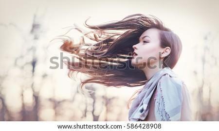 beautiful young woman autumn...