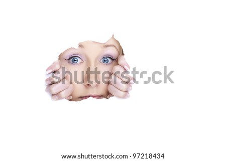Beautiful young woman behind blank banner on white background. Glamour portrait.