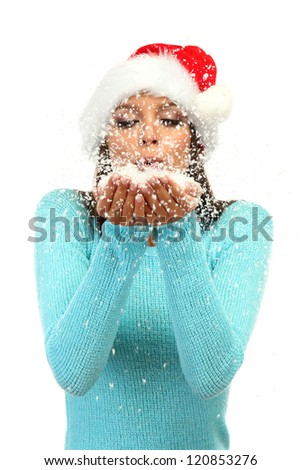 beautiful young woman blowing snow, isolated on white