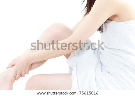 beautiful young woman caring for her legs isolated on white background